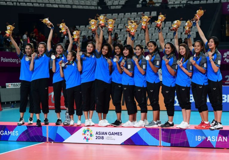 Silver medallists from Thailand celebrate during the medals ceremony during the women's volleyball final at the 2018 Asian Games in Jakarta on September 1, 2018. 26 members of the team tested positive after accepting China's Sinovac inactivated virus injection. All will miss the upcoming Volleyball Nations League tournament.