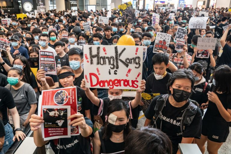 Protesters occupy the arrival hall of the Hong Kong International Airport during a demonstration on August 12, 2019. A reporter from the Hong Kong Epoch Times, an international publication critical of the Chinese Communist Party, was attacked by a man with a baseball bat after leaving her apartment on May 11.