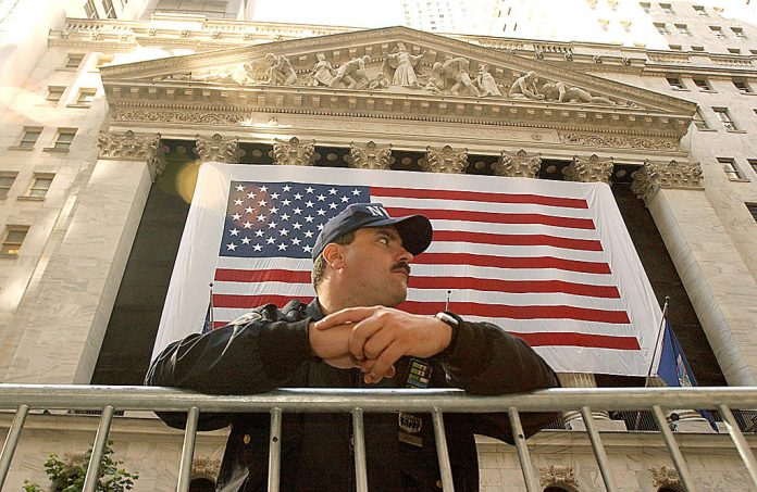 New York Police Officer Chris Hunt stands guard in front of the New York Stock Exchange October 11, 2001 in New York City on the one month anniversary of the terrorist attacks on the World Trade Center and the Pentagon in Washington D.C. A Newsweek expose revealed the Pentagon manages a 'clandestine army' 60,000 strong composed of domestic and foreign, online and real life agents operating in society under government-backed false identities.