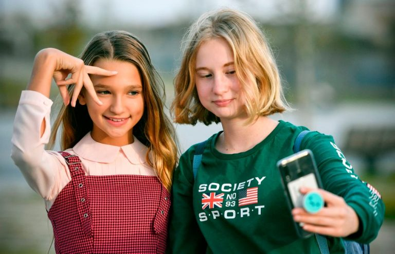 Russian child blogger Liza Anokhina (L), 12, participates in a shoot for her blog in a Moscow park on September 13, 2019. Liza Anokhina is one of Russia's most popular child bloggers with 2.3 million followers on Instagram. 44 State Attorneys General called on Mark Zuckerberg to abandon the installation of a version of Instagram targeting children, citing child sexual exploitation, depression, and suicide as inherent risk factors.