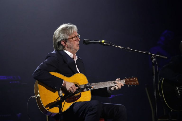 """Eric Clapton on stage during The Fashion Awards 2019 held at Royal Albert Hall on December 02, 2019 in London, England. The singer suffered """"disastrous"""" side effects after accepting the AstraZeneca injection."""