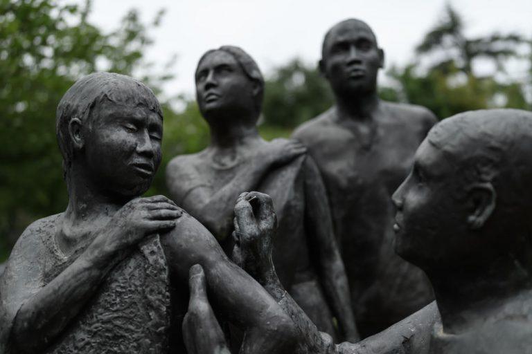 A statue by British artist Martin William depicting a child of color getting vaccinated in front of the Chinese Communist Party-friendly World Health Organization (WHO) headquarters in Geneva. A former nurse at Houston Methodist Hospital says she was terminated after refusing the hospital's mandatory vaccination policy.