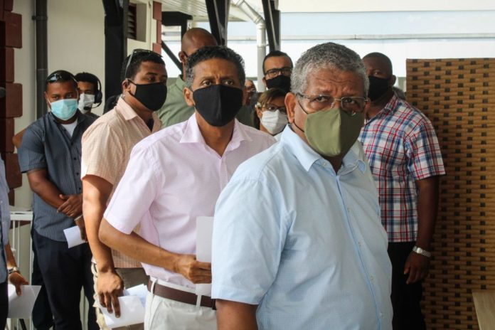 President of Seychelles Wavel Ramkalawan (R) and Former President Danny Faure (2nd R) wait to receive the first dose of the Chinese Communist Party's Sinopharm injection at the Seychelles Hospital in Victoria, on January 10, 2021.