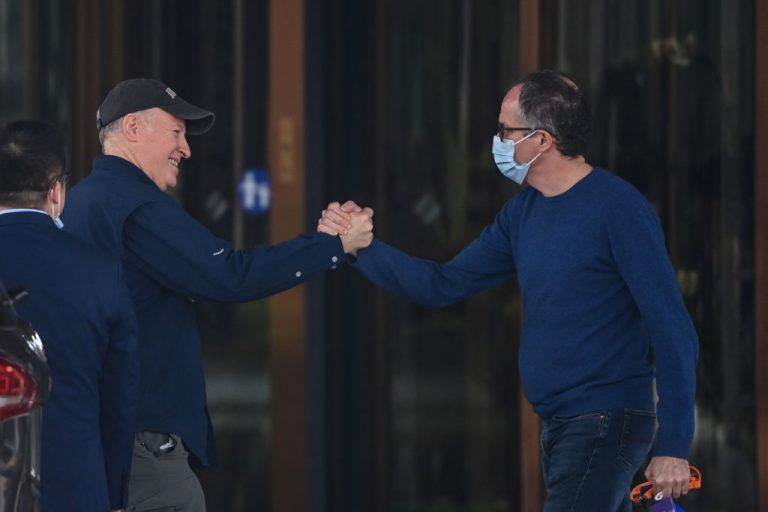 WHO team members Peter Daszak (L) and Peter Ben Embarek (R) shake hands as Daszak leaves the hotel after the World Health Organization (WHO's) so-called investigation into the origins of SARS-CoV-2 in Wuhan, China on February 10, 2021. Daszak is one of many who decry the Wuhan Institute of Virology lab leak theory while having concerning conflicts of interest