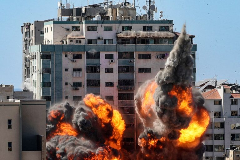 """A ball of fire erupts from Hamas controlled Jala Tower as it is destroyed in an Israeli airstrike in Gaza City on May 15, 2021. The Israeli Defense Force said it showed Washington the smoking gun that Hamas was operating in the building, using the press as a """"human shield."""""""