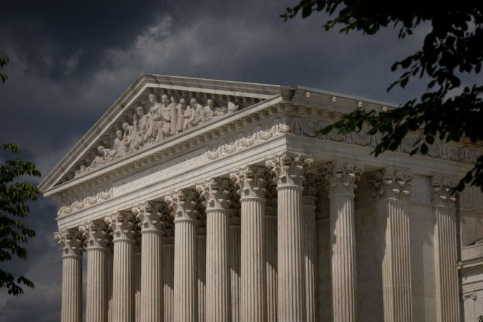 Clouds are seen above The U.S. Supreme Court building on May 17, 2021 in Washington, D.C. The Supreme Court said that it will hear a Mississippi abortion case that challenges Roe v. Wade. They will hear the case in October, with a decision likely to come in June of 2022.