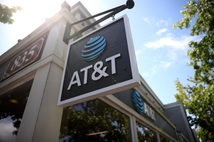A sign is posted in front of an AT&T retail store on May 17, 2021 in San Rafael, California. AT&T, the world's largest telecommunications company, announced a deal with Discovery, Inc. which will spin off AT&T's WarnerMedia and be combined with Discovery to create a new standalone media company.