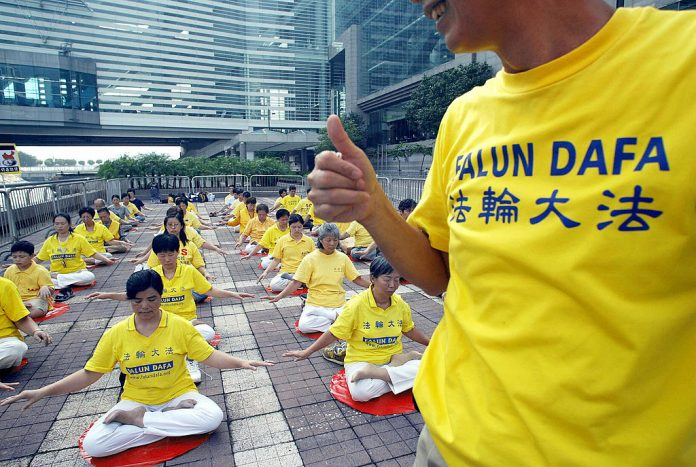 Falun Gong practitioners take part in a silent protest calling to bring former General Secretary of the Chinese Communist Party, Jiang Zemin, to justice in Hong Kong on October 1, 2004. Minghui Publishing was awarded the highly acclaimed Benjamin Franklin Award for its groundbreaking book, Minghui Report: The 20-Year Persecution of Falun Gong in China.