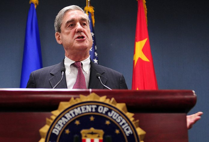 """Robert Mueller, former head of the FBI, briefs the media at the U.S. Embassy in Beijing, 30 January 2008, after talks with the Chinese Communist Party. Mueller lauded the Party's """"anti-terrorism measures,"""" which cracked down on persecuted groups, democracy protestors, and people of spiritual faith, installed ahead of the 2008 Summer Olympics."""