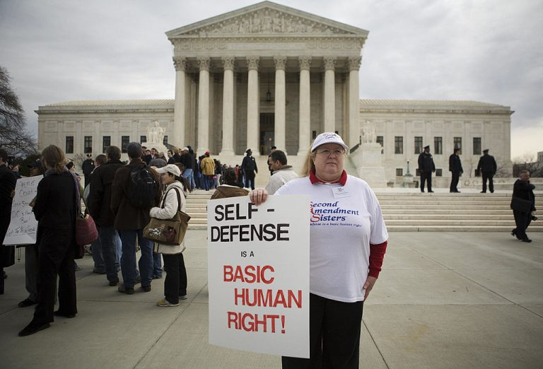 A gun ownership supporter holds a placard on March 18, 2008 outside of the Supreme Court in Washington, DC. The right of Americans to keep guns was tested in the Supreme Court for the first time in seven decades when it heard a challenge over the U.S. capital's restrictions on gun ownership. The court ultimately ruled to protect an individual's right to keep and bear arms.