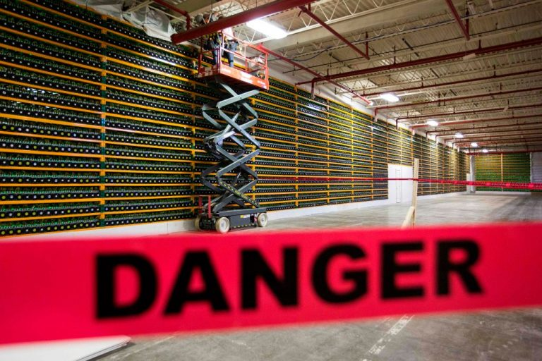 A wall of Bitcoin mining hardware at Bitfarms in Saint Hyacinthe, Quebec on March 19, 2018. Bitcoin, lauded by pundits and holders as a future, decentralized, world currency that will free mankind from the trappings of central bank issued fiat currencies, sits firmly in the control of Communist China.