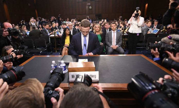 Mark Zuckerberg arrives to testify before a joint hearing of the U.S. Senate Commerce, Science and Transportation Committee and Senate Judiciary Committee on Capitol Hill, April 10, 2018 in Washington, D.C. Facebook has been tied to many scandals involving the Chinese Communist Party recently, most notably a partner of its Journalism Project who teams up with Tsinghua University in the creation of 'Marxist Journalism.'