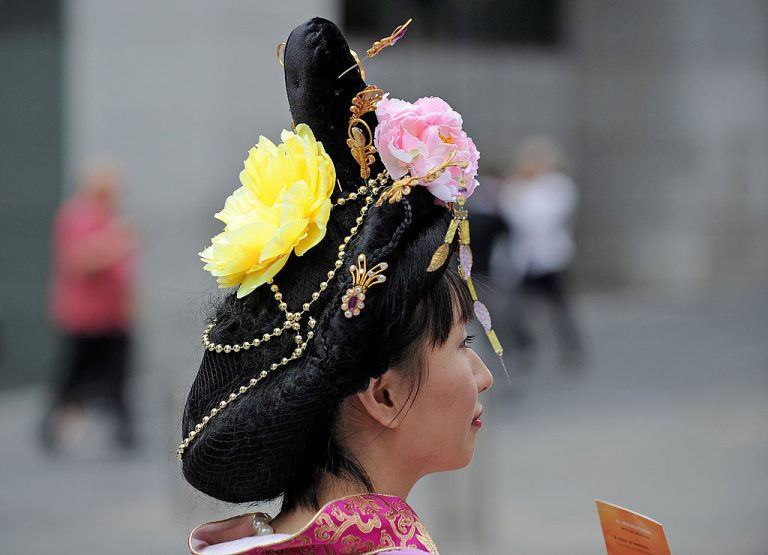 """Women's Hair - A young woman in traditional ancient Chinese dress promotes the classical Chinese experience through """"Shen Yun Performing Arts"""" in Sydney on April 6, 2010. Shen Yun Performing Arts, based in New York and independent of China's regime, presents the five-millennia-old artistic tradition of classical Chinese dance."""