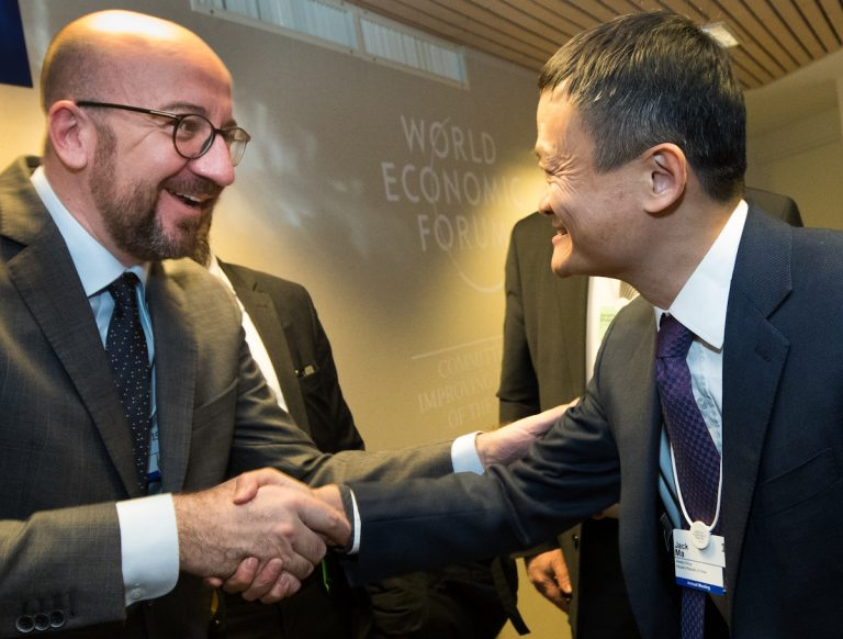 Belgian Prime Minister Charles Michel shakes hands with Alibaba Group's Jack Ma at the 2018 World Economic Forum in Davos, Switzerland. The Belgium government's handing over of the Liege airport to become a distribution center for the Chinese Communist Party-linked company is a major national security problem, says the country's Justice Minister.