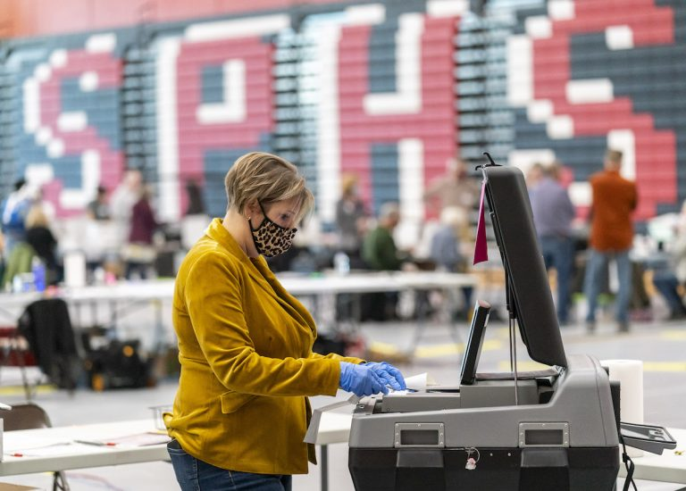 Voting errors in recent county elections in Pennsylvania that disproportionately affected Republicans have elicited concerns about election integrity. Pictured is poll worker Rebecca Brandt feeding a voting tabulation machine with absentee ballots in the gym at Sun Prairie High School on November 3, 2020 in Sun Prairie, Wisconsin.