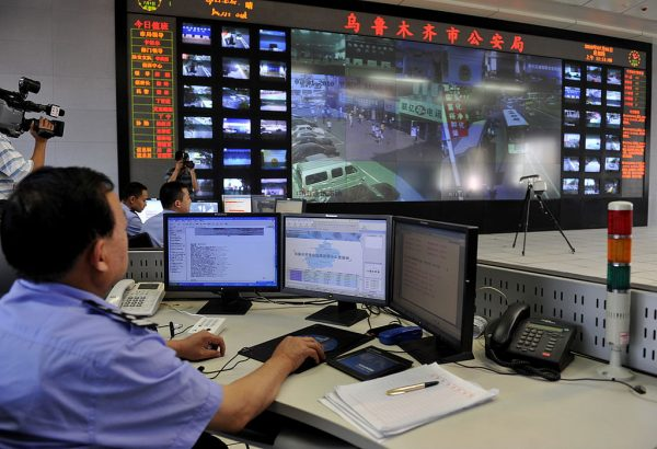 Chinese surveillance personnel watch screens showing public areas monitored by cameras in Urumqi on July 1, 2010. Sugon, one of the 16 companies released from U.S. export controls, controls the Urumqi Cloud Computing Center used to facilitate the genocide of Uyghur Muslims.