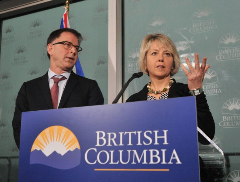 British Columbia Minister of Health Adrian Dix and Bonnie Henry, Provincial Health Officer, speak to the media about SARS-CoV-2 in Vancouver, British Columbia, on January 31, 2020. Whistleblower doctor, Charles Hoffe, was disciplined by a Canadian health authority after speaking out about neurological disorders in First Nations patients who received the Moderna COVID-19 mRNA injection in his village of Lytton, BC.