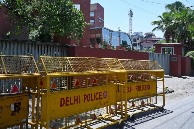 Police barricades are seen in front of the gate of the Twitter India's office at Crescent building in New Delhi on May 25, 2021, as police served a notice at Twitter's offices over flagged governments tweets as 'manipulated media' a day before.