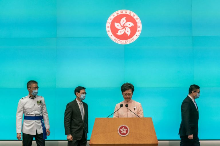 Newly promoted Hong Kong government officials Chief Secretary John Lee Ka-chiu, Police Commissioner Raymond Siu Chak-yee, and Secretary for Security Chris Tang Ping-keung, attend a press conference with Hong Kong Chief Executive Carrie Lam Cheng Yuet-ngor, at the Central Government Offices on June 25, 2021 in Hong Kong, China. Beijing confirmed on June 25 a reshuffle of Hong Kong's top figureheads as the city will continue to install Communist Party rule, including the notorious Article 23, ahead of polls in September and Legislative Council in December.