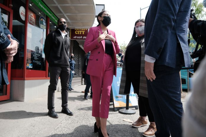 Rep. Alexandria Ocasio-Cortez (D-NY) is joined by New York Mayor Bill de Blasio as they promote vaccine acceptance in the Bronx on Friday afternoon on May 7, 2021 in New York City. AOC, a Democratic Socialist of America member, blames Donald Trump for her grandmother living in squalor in Puerto Rico.