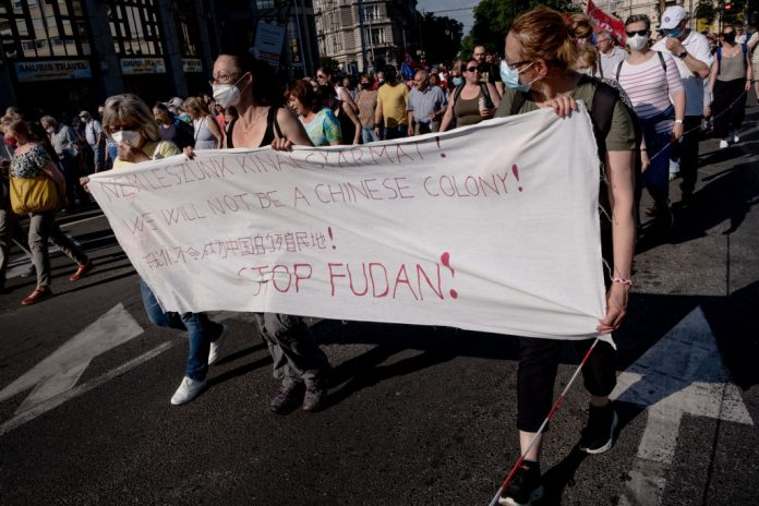 Protestors march during a demonstration against the planned Chinese Fudan University campus on June 5, 2021 in Budapest, Hungary. On June 2, the mayor of Budapest renamed four streets on the outskirts of the proposed site to host a university campus funded by by Chinese Communist Party, after the CCP's political opponents.