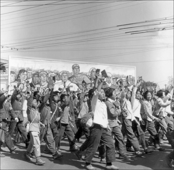 """""""Red Guards,"""" high school and university students, waving copies of Chairman Mao Zedong's """"Little Red Book,"""" parade in June 1966 in Beijing's streets at the beginning of the Cultural Revolution. There are frightening similarities between today's race struggle politics and Mao and the CCP's Cultural Revolution."""