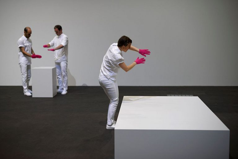"""David Balula's """"Mimed Sculptures,"""", a performance of mimes tracing the invisible presence of art historically significant sculptures is performed at Unlimited show, the Art Basel's pioneering exhibition on June 14, 2016. An Italian """"artist"""" sold an """"invisible"""" sculpture for $18,000."""