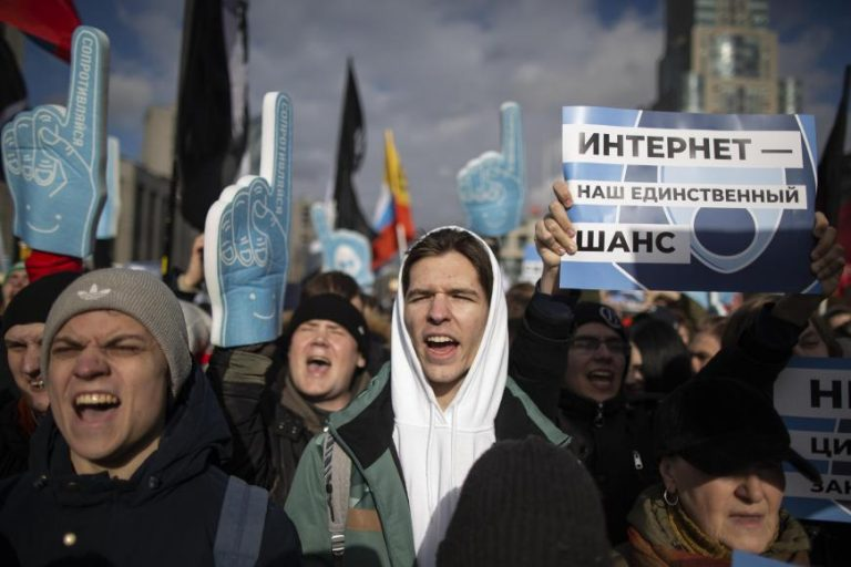 """Demonstrators, with a poster on the right reading """"internet is our only chance,"""" attend the Free Internet rally in response to a bill making its way through parliament calling for all internet traffic to be routed through servers in Russia— making VPNs (virtual private networks) ineffective, in Moscow, Russia, Sunday, March 10, 2019."""