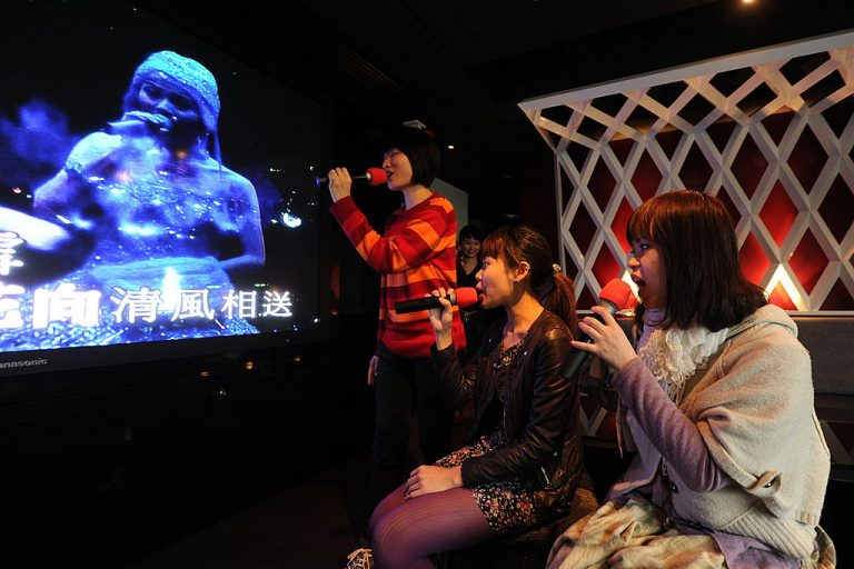 Singers perform at a karaoke lounge in Hong Kong on February 11, 2011. The Chinese Communist Party wants to ensure social stability by centrally overseeing what songs can be sung in the country's karaoke bars.