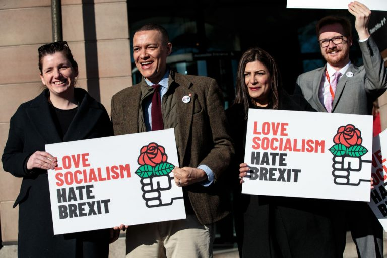 UK Labour MPs hold placards promoting socialism as they demonstrate against Brexit during a public relations stunt outside Portcullis House on March 5, 2019 in London, England. A study by UK think tank Institute of Economic Affairs found 67 percent of Millennials and Generation Z say they long to live under socialist policies. The oldest Millennials would be in their 40s today.