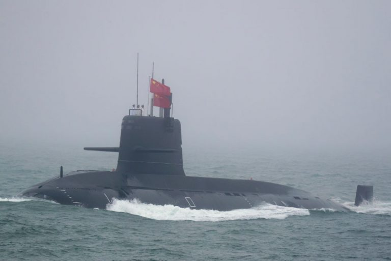A Great Wall 236 submarine of the Chinese People's Liberation Army (PLA) Navy, billed by Chinese state media as a new type of conventional submarine, participates in a naval parade to commemorate the 70th anniversary of the founding of China's PLA Navy in the sea near Qingdao, in eastern China's Shandong province on April 23, 2019.