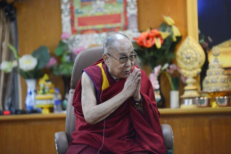 Tibetan spiritual leader the Dalai Lama gestures as he interacts with media members during an event in McLeod Ganj on October 25, 2019.