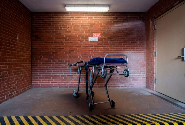 An empty gurney is seen outside of a hospital's morgue in Baltimore, Maryland on December 23, 2020 during the Covid-19 pandemic. A 45-year-old Baltimore Woman, Robin Spring Saunders, passed away after complications after taking the second dose of a SARS-CoV-2 vaccine required by her new employer, John Hopkins Hospital