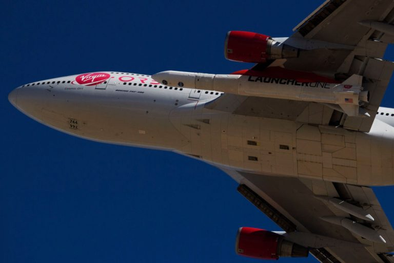 """The Virgin Orbit """"Cosmic Girl""""—a modified Boeing Co. 747-400 carrying a LauncherOne rocket under its wing—takes off for the Launch Demo 2 mission from Mojave Air and Space Port on January 17, 2021 in Mojave, California."""