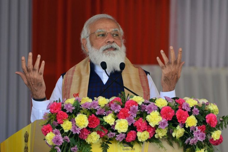 Indian Prime Minister Narendra Modi gestures as he addresses a public meeting at Jerenga Pathar in Sivasagar district of India's Assam state on January 23, 2021.