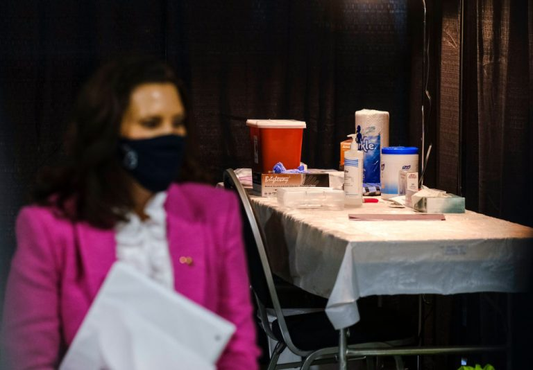"""A vaccine station is prepared for Michigan Governor Gretchen Whitmer and a group of """"Covid-19 Student Ambassadors"""" to accept the Pfizer variant of the SARS-CoV-2 injection during a vaccine acceptance stunt at Ford Field on April 6, 2021 in Detroit, Michigan. Vaccine acceptance lotteries in Michigan and Idaho were complete flops in stimulating vaccine uptake among citizens."""