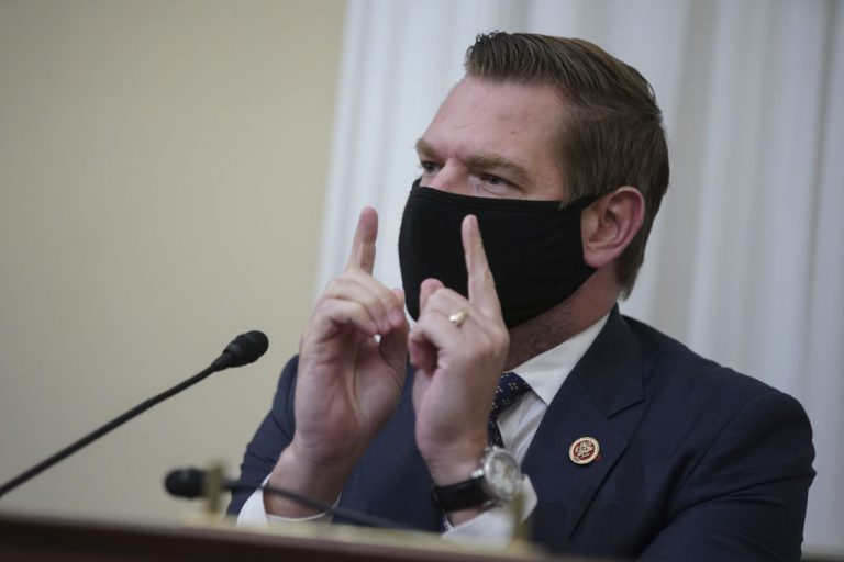 """Rep. Eric Swalwell (D-CA) wears a black mask while speaking during a House Intelligence Committee hearing on April 15, 2021 in Washington, D.C. Reporting from Breitbart citing unnamed """"intelligence and national security sources"""" claims the U.S. Intelligence Community has a completed, yet still classified, report confirming Swalwell had sex with Chinese Communist Party Ministry of State Security honeypot Christine """"Fang Fang"""" Fang."""