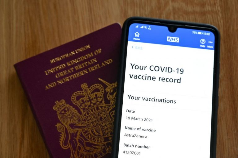 An illustration picture shows a smartphone screen displaying a Covid-19 vaccine record on the National Health Service (NHS) app in London on May 18, 2021.