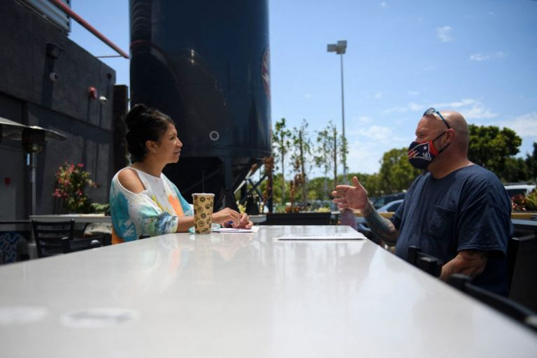 Ray Liberge (R) interviews for a job as a line cook with a human resources manager before being hired during a Zislis Group job fair at The Brew Hall on June 23, 2021 in Torrance, California. As many as 1.84 million Americans may return to work when the Biden administration's additional $300 per week in unemployment insurance payouts come to a full stop