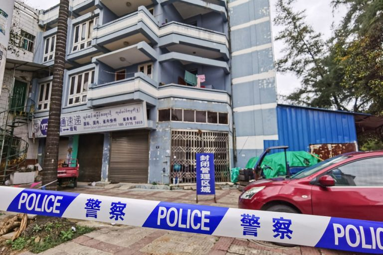 Police tape blocks access to a building as part of COVID-19 coronavirus measures in the city of Ruili which borders Myanmar, in China's southwestern Yunnan province on July 5, 2021. - China OUT