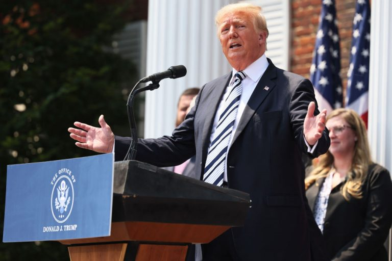"""Former U.S. President Donald Trump speaks during a press conference announcing a trio of class action lawsuits against Facebook, YouTube, and Twitter at the Trump National Golf Club Bedminster on July 7, 2021 in New Jersey. Trump said freedom of speech was installed in America's Constitution by the founding fathers as a method for """"the prevention of horror."""""""