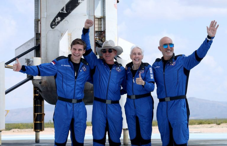 Blue Origin's New Shepard crew—(L-R) Oliver Daemen, Jeff Bezos, Wally Funk, and Mark Bezos—pose for a picture in Van Horn, Texas near the booster after flying into space in the Blue Origin New Shepard rocket on July 20, 2021. Mr. Bezos and the crew were the first human spaceflight for the company.