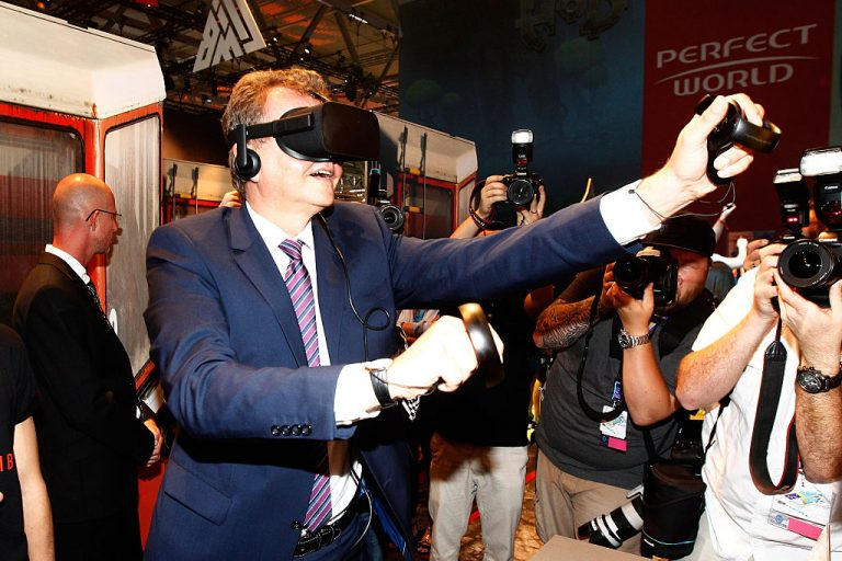 Martin Doermann tries out Crytek's CryEngine at the Gamescom 2016 gaming trade fair during the media day on August 17, 2016 in Cologne, Germany. According to a German newspaper, Chinese Communist Party tech giant Tencent is looking to acquire Crytek for its CryEngine, used to create military simulations.
