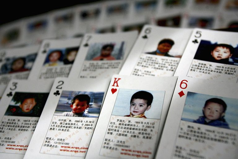 Playing cards showing details of missing children are displayed on March 31, 2007 in Beijing, China. The cards showing photographs and information of 27 missing children were created by Shen Hao, the founder of missing persons website, 'www.xrqs.com'.