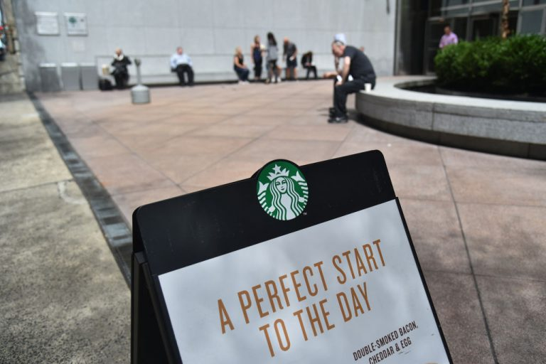 A sign for Starbucks is seen on a street in New York City, on May 11, 2018. Northern Territory of Australia man, Hayden Williams, was arrested by police for drinking coffee in public on the way back to his car amid a lockdown.