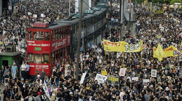Trams sit stranded as thousands of people block the streets in a huge protest march against a controversial anti-subversion law known as Article 23 in Hong Kong, July 1, 2003