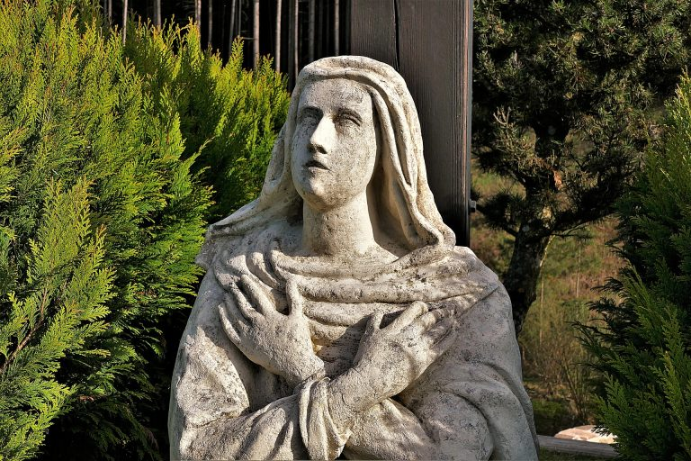 A woman smashed two statues outside a church in Queens