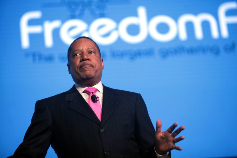 Leading contender in the California Recall Election, Larry Elder, speaks at the 2016 FreedomFest at Planet Hollywood in Las Vegas, Nevada. A felon was found with 300 unopened absentee ballots for the California Recall Election in Torrance, a concerning similarity to a ballot harvesting scandal in Minnesota's Somali-American community that benefitted Democrat Rep. Ilhan Omar in the Nov. 3, 2020 Federal Election.