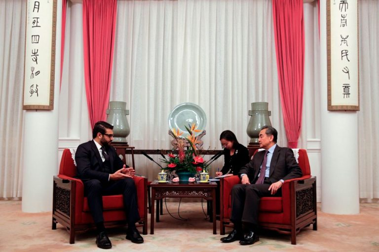 Afghanistan's former National Security Advisor Hamdullah Mohib (L) talks to Chinese Foreign Minister Wang Yi during their meeting at Zhongnanhai in Beijing on January 10, 2019. Joe Biden's China Policy Coordinator, Melanie Hart, co-authored a 2015 paper with the Center for American Progress and the China-United States Exchange Foundation advocating America pave the way for the Chinese Communist Party's Belt and Road Initiative in Afghanistan.