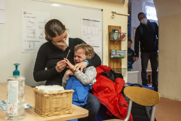 A mother nasal probes her child for a COVID PCR test at a kindergarten on April 12, 2021 in Prague, Czech Republic. The nature of pandemic measures in public school in connection with forced online learning has driven many parents to homeschool their children as an alternative.